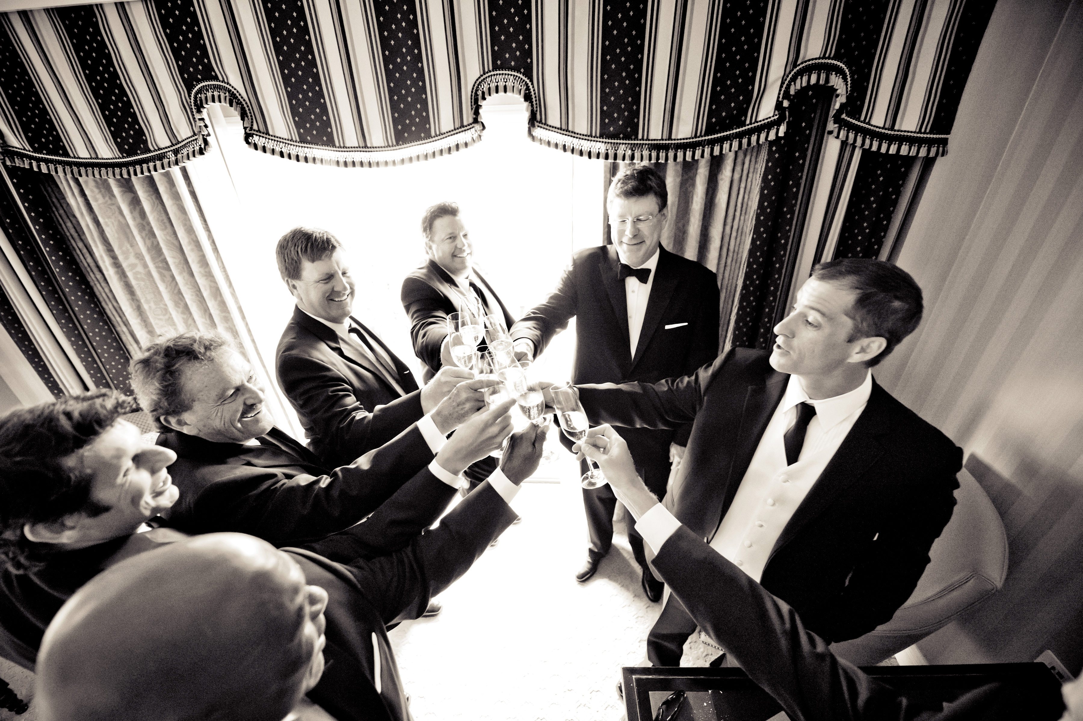 fun and playful wedding photo poses for grooms and groomsmen