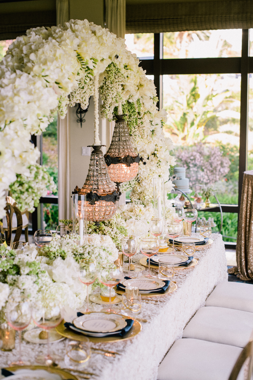 vintage inspired tablescape with flower arch for wedding styled shoot