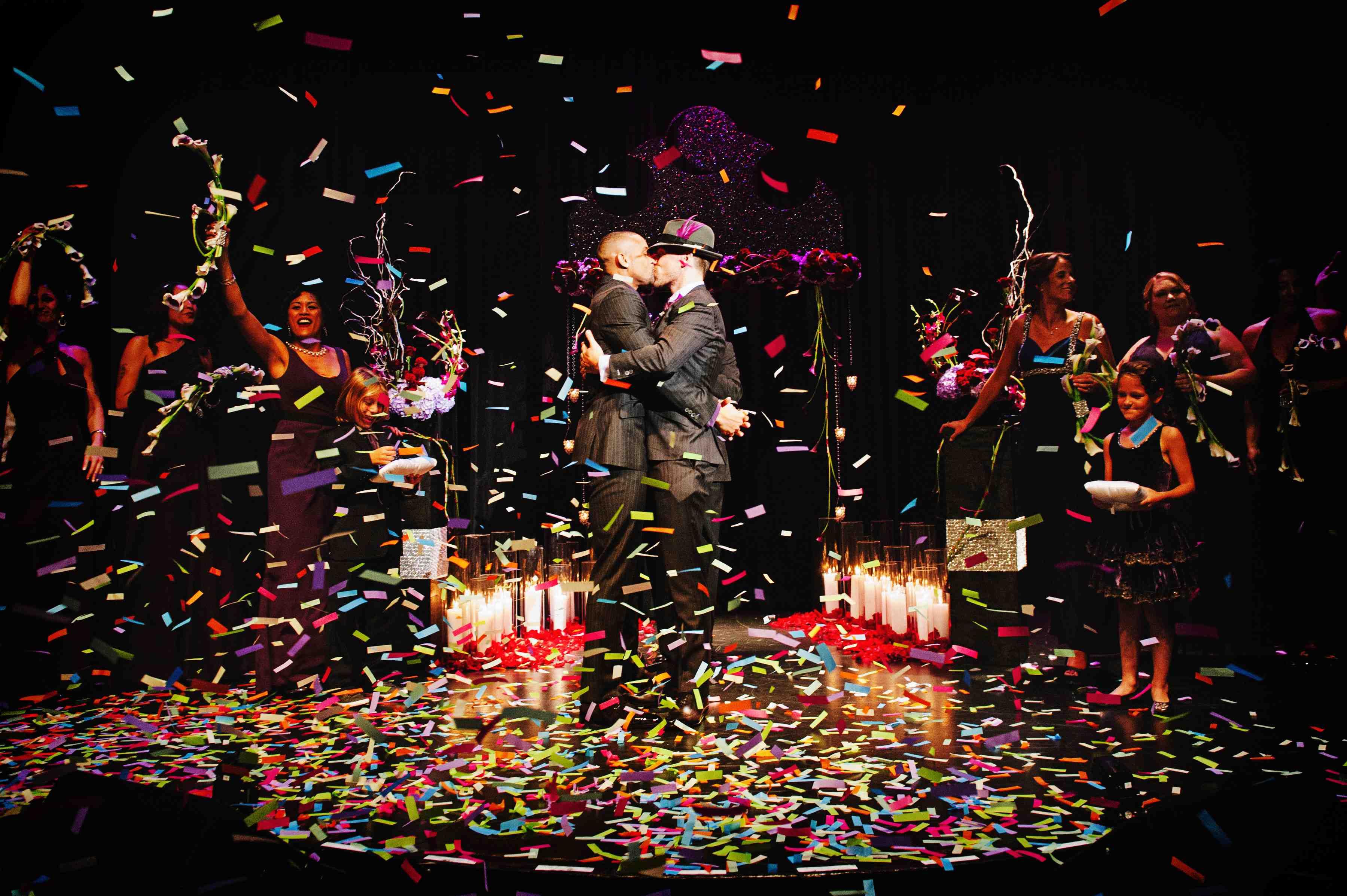 rainbow confetti at gay wedding as husbands kiss