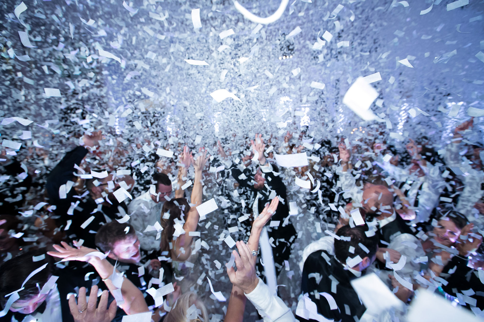 wedding with confetti falling over dance floor
