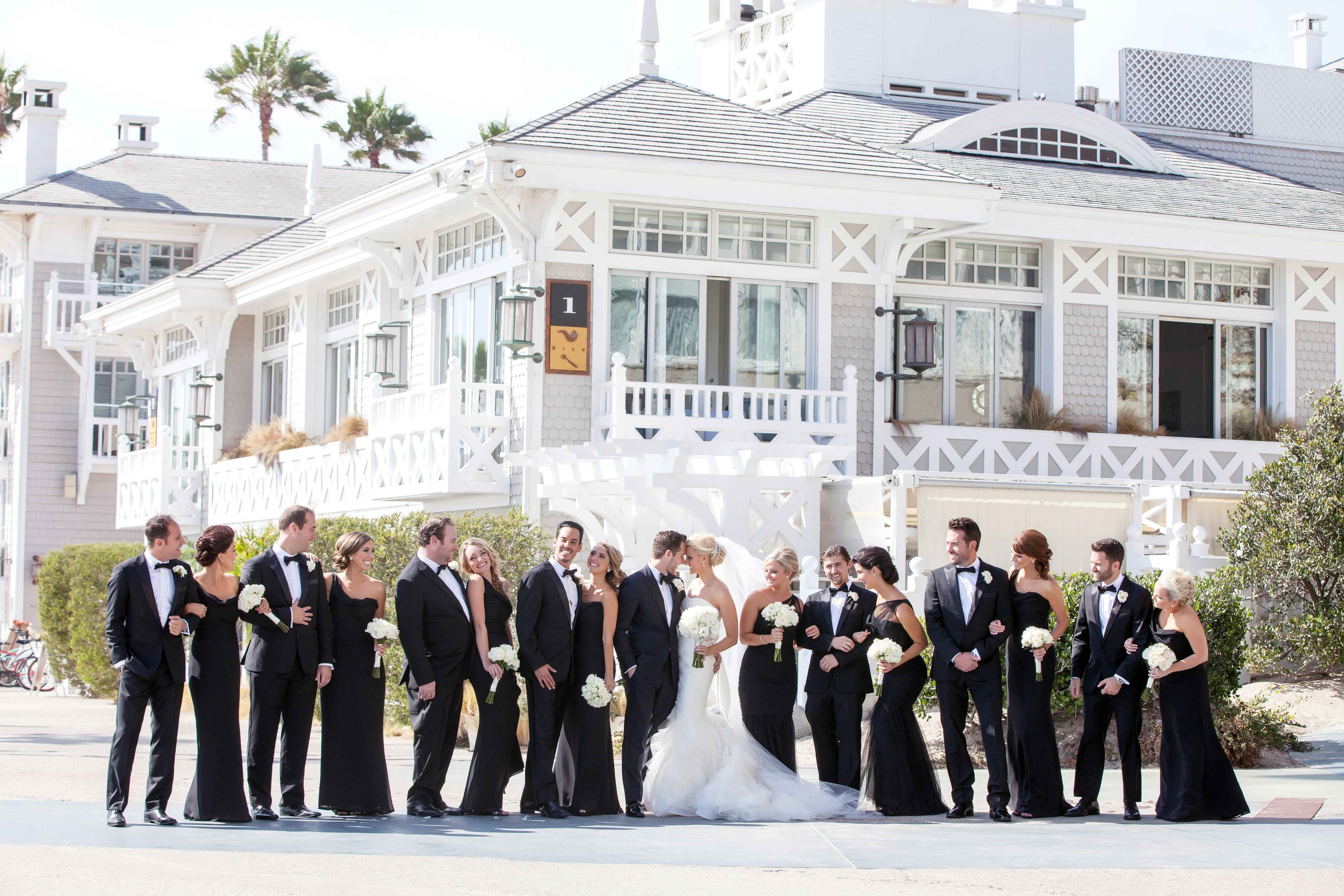 Shutters on the Beach exterior with bridesmaids groomsmen
