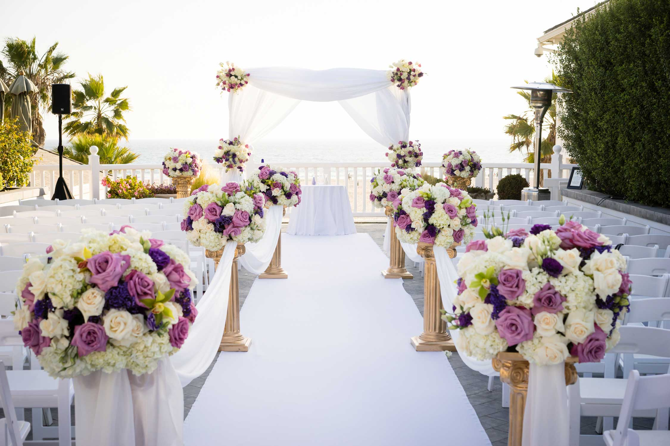 Shutters on the Beach Pacific Terrace wedding venue purple flowers