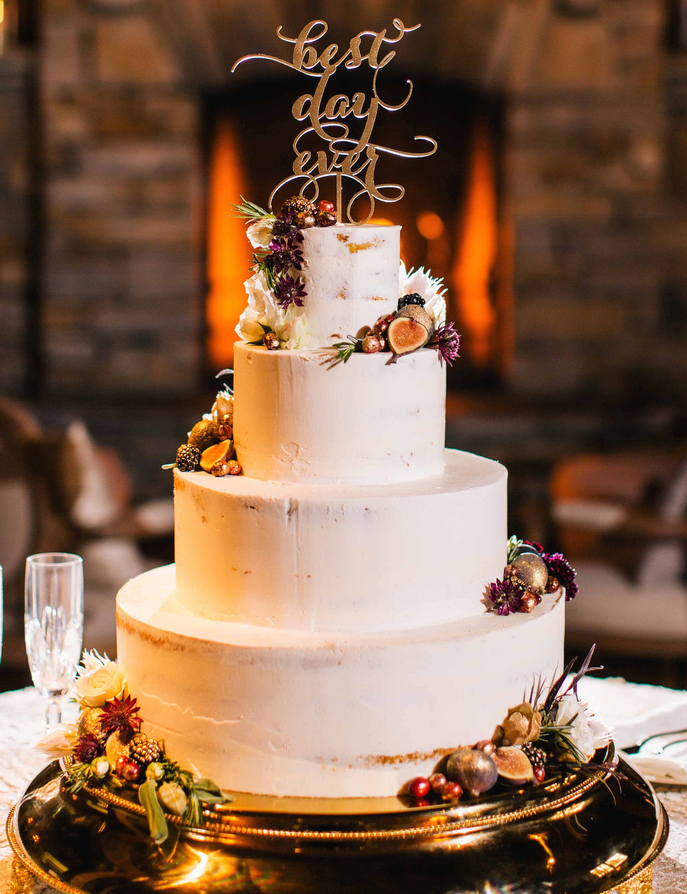 White wedding cake for fall wedding with best day ever cake topper and figs