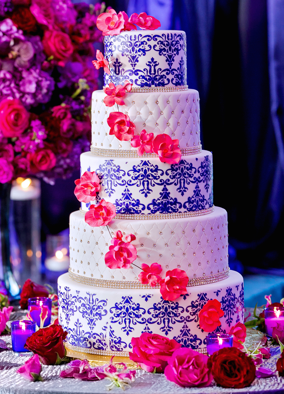 Indian wedding cake with white tufted layers and purple damask print design