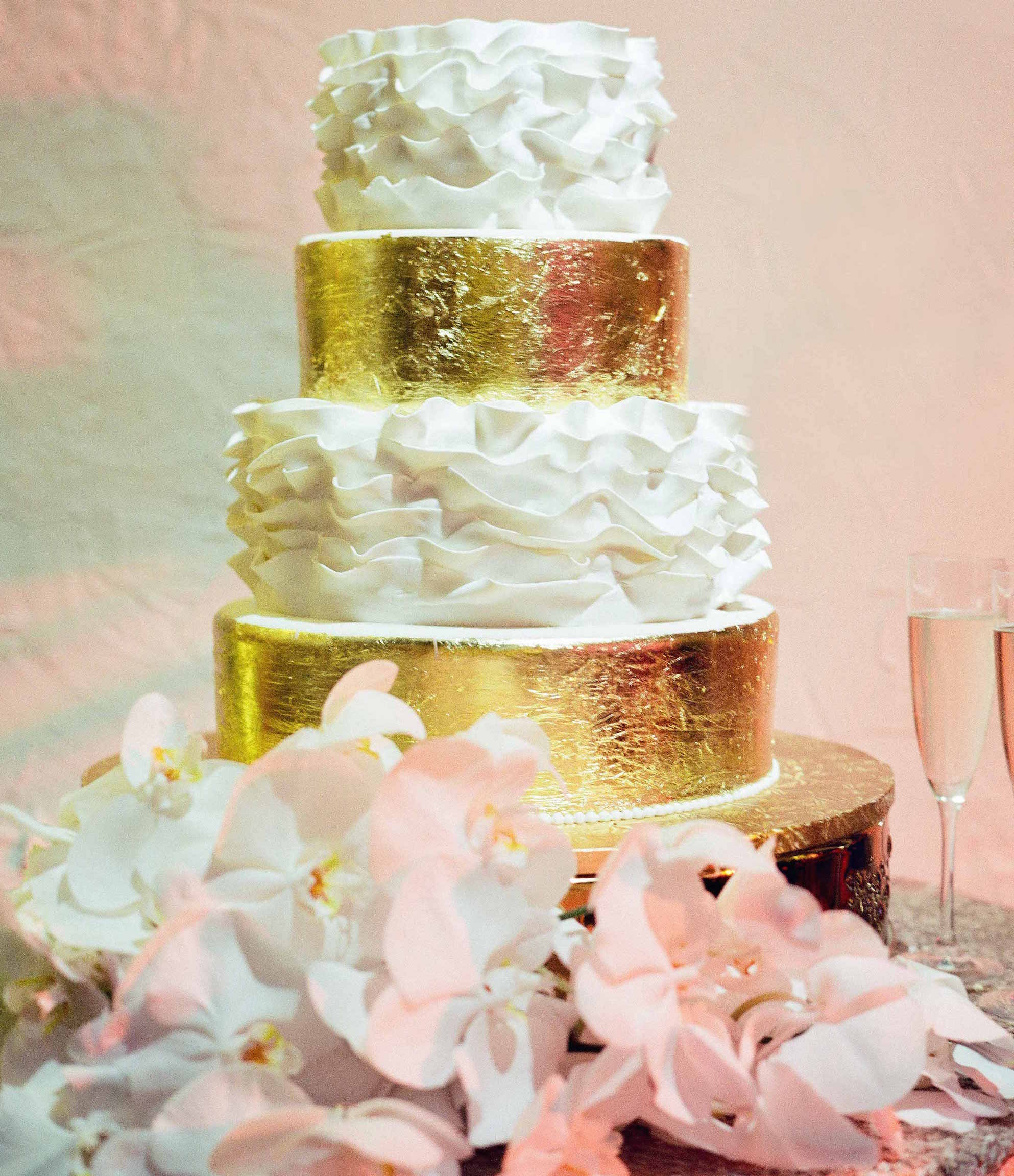 White ruffle and gold foil wedding cake