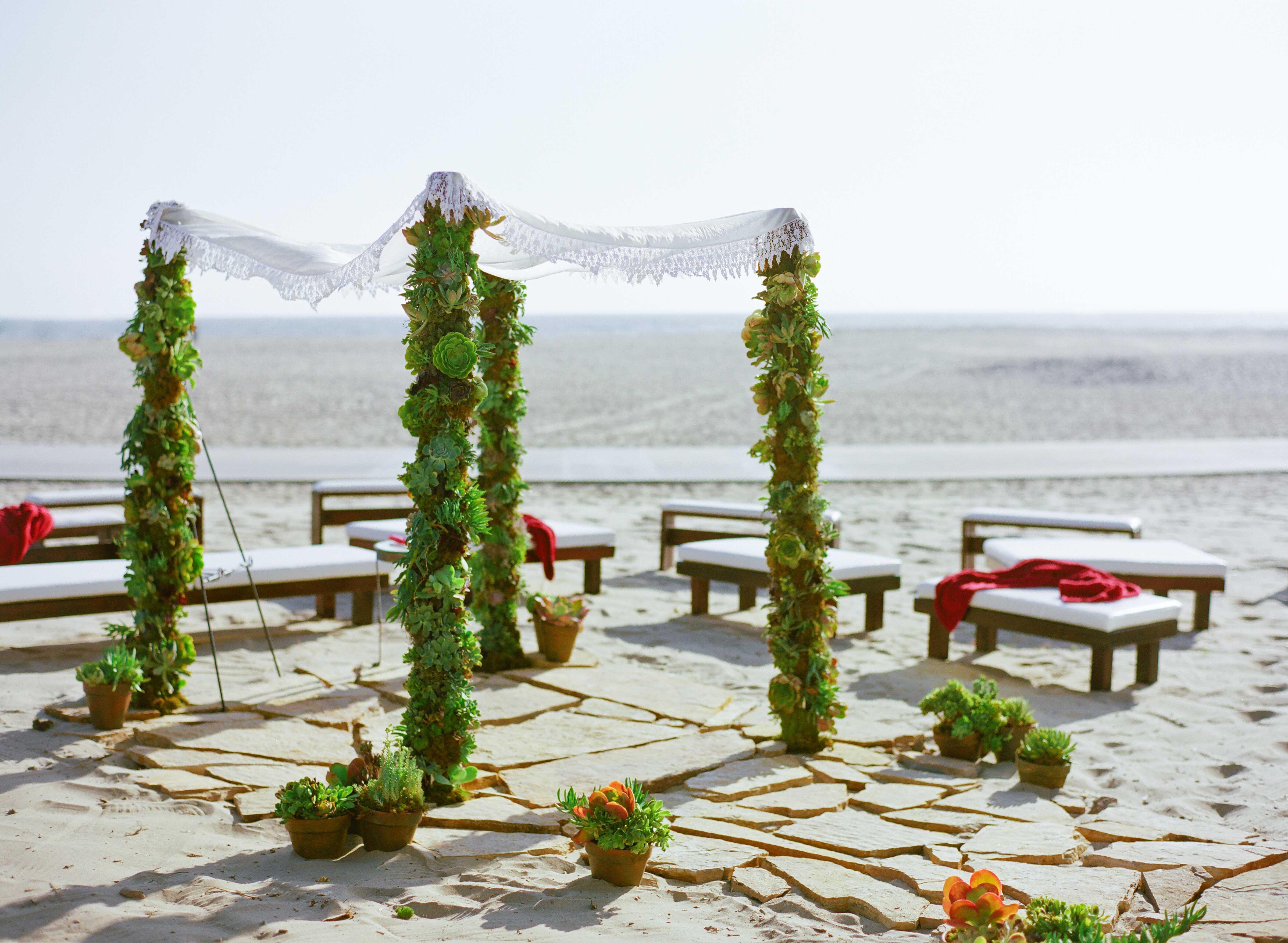 Casa Del Mar wedding beach ceremony with succulent arch
