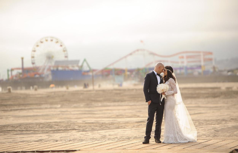 Bride and groom on beach at Casa Del Mar