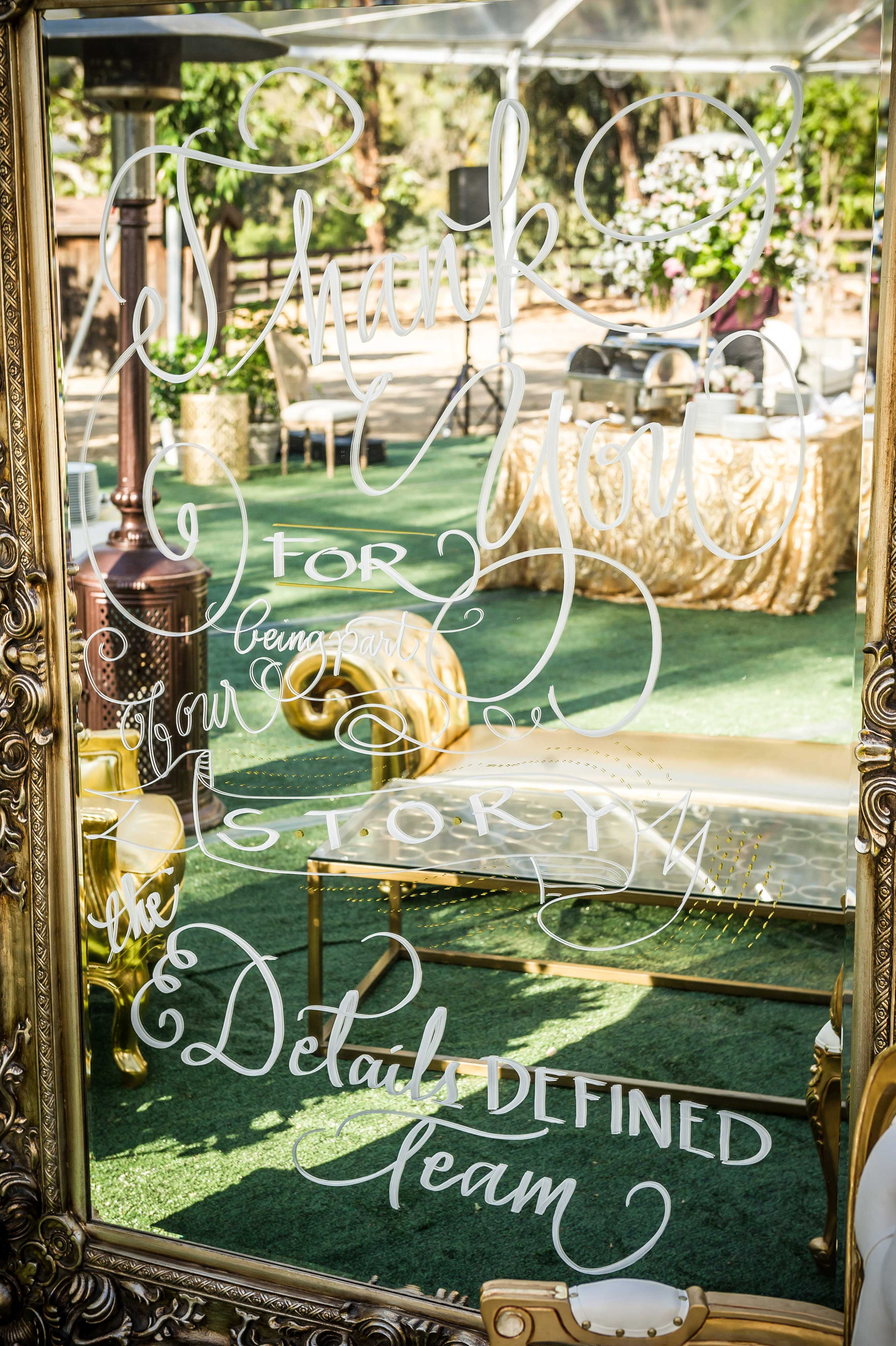 Gold frame mirror with writing Details Defined party at Painted Sky Ranch