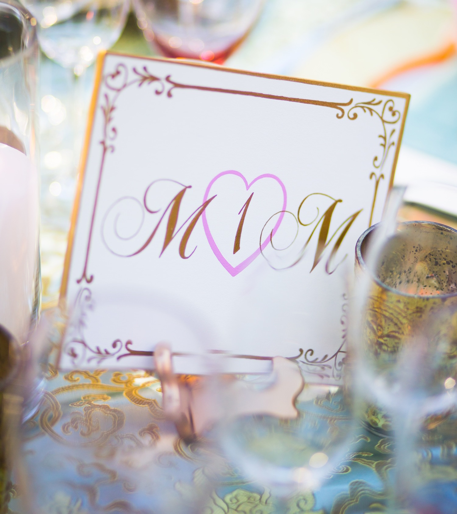 Pink and gold table number with initials in hearts wedding reception rehearsal dinner