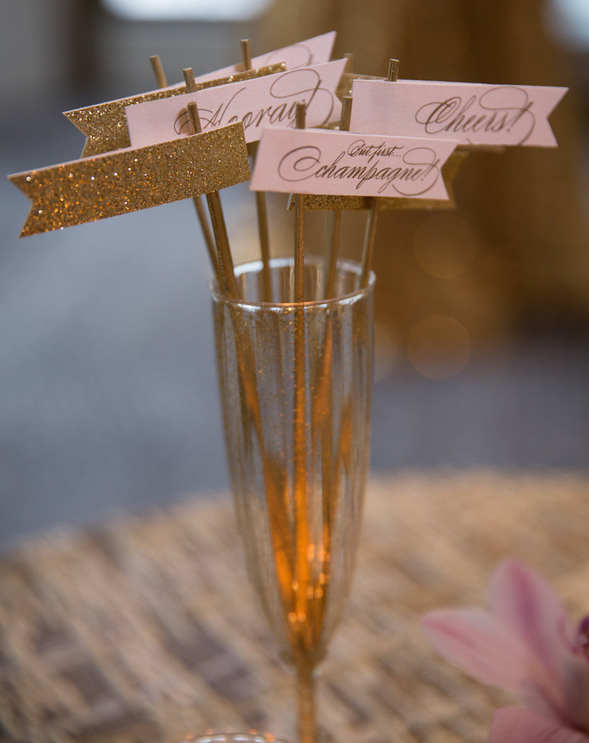 Pink and gold glitter champagne flags drink stirrers