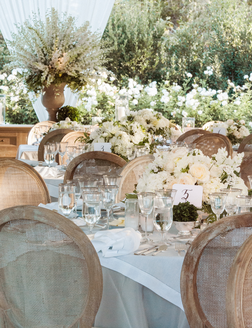 Elegant wedding centerpieces - Brown Chairs Around Rustic Elegant Wedding Reception With White And Cream Flower Rustic Wedding Centerpieces