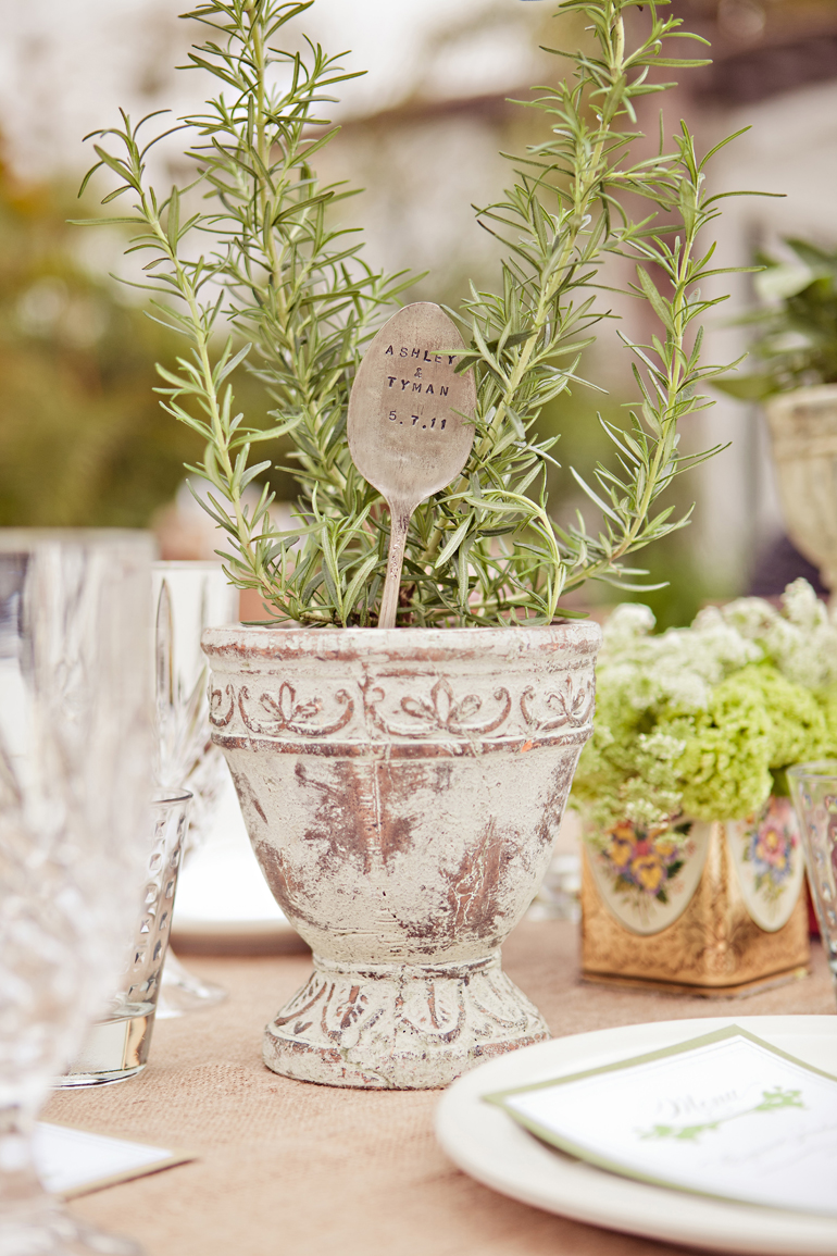 Rustic urn wedding centerpiece with fresh herbs rosemary thyme spoon stamped with wedding date