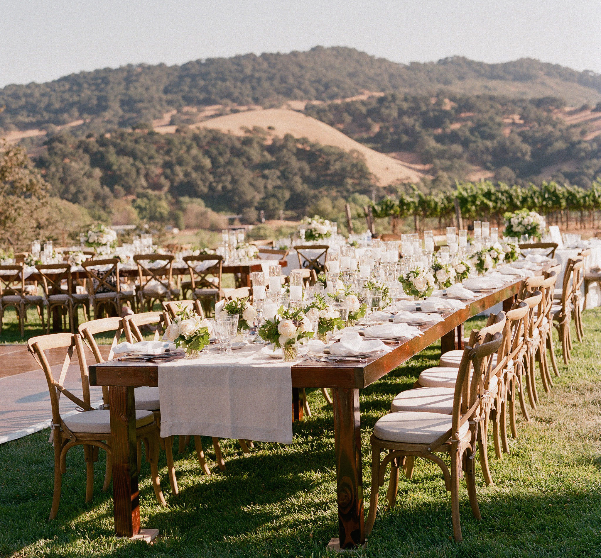 Rustic wedding reception table centerpieces at winery vineyard wedding