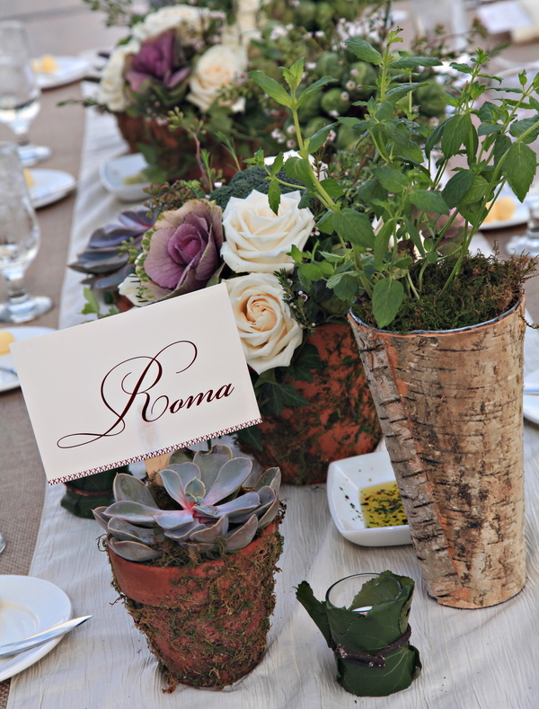 Rustic wedding centerpieces low terracotta pots covered in moss and birch wrapped vases