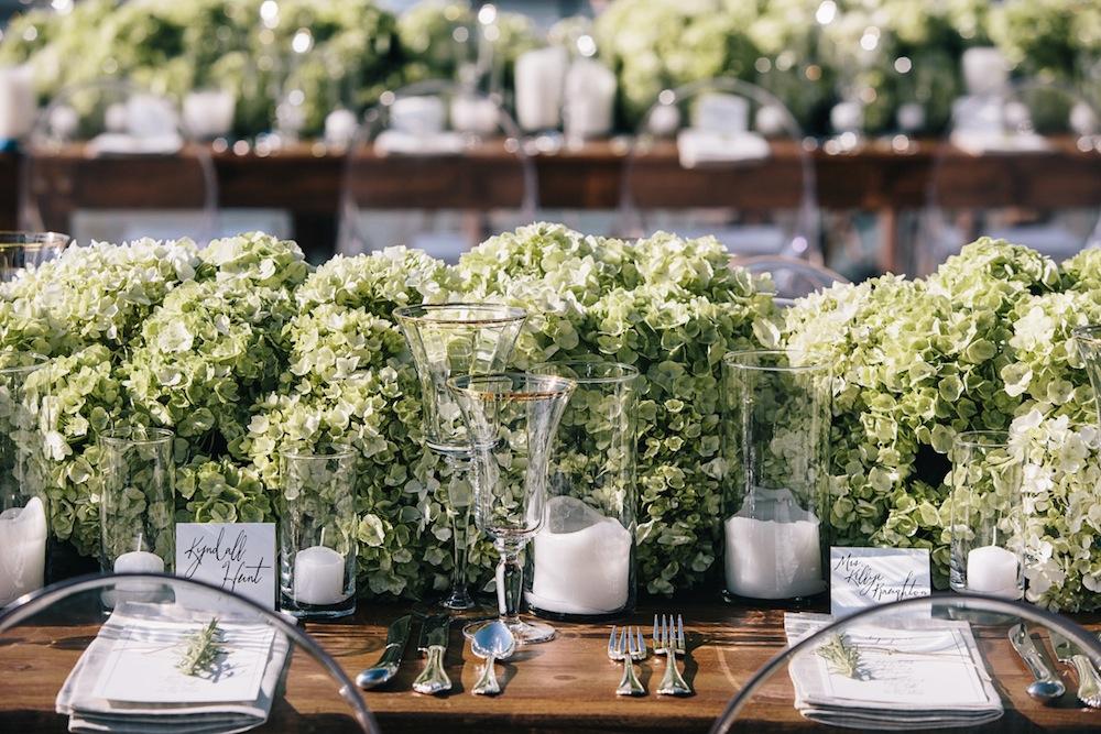 Green hydrangea flower runner rustic wedding centerpiece idea on wood table
