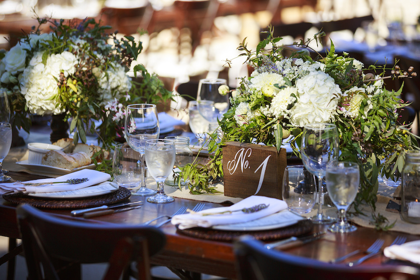White wedding centerpiece with wood block table number rustic wedding centerpieces ideas