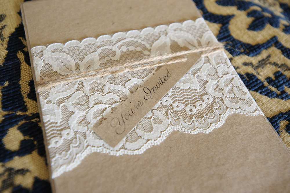 Tan kraft paper wedding invitation with lace and twine
