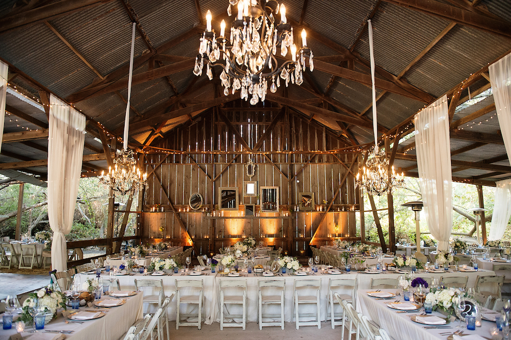 Wedding reception in barn with chandeliers Melissa Egan bride