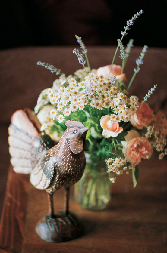 Rustic wedding centerpiece with rooster decoration