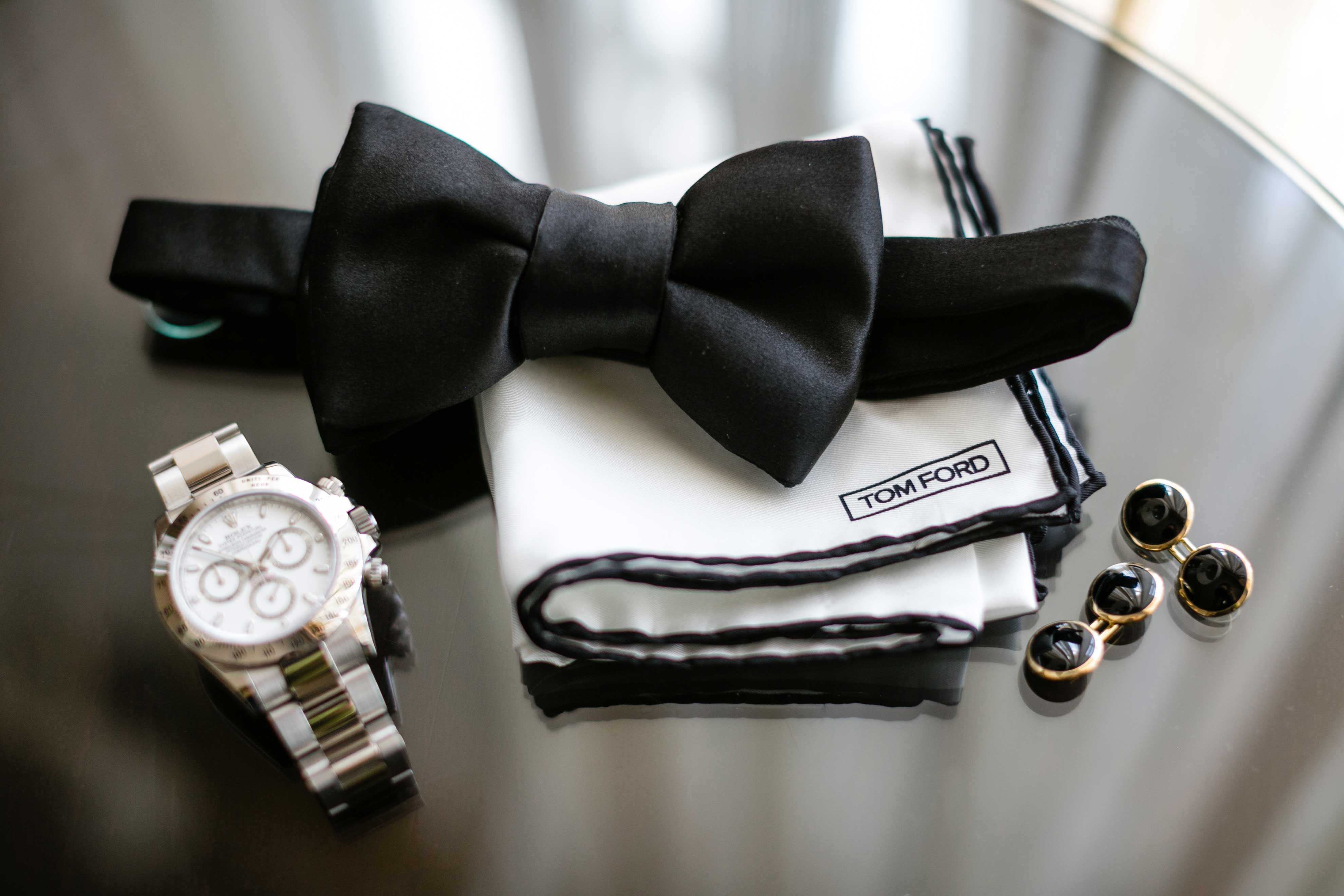 Groom's accessories on table on wedding day