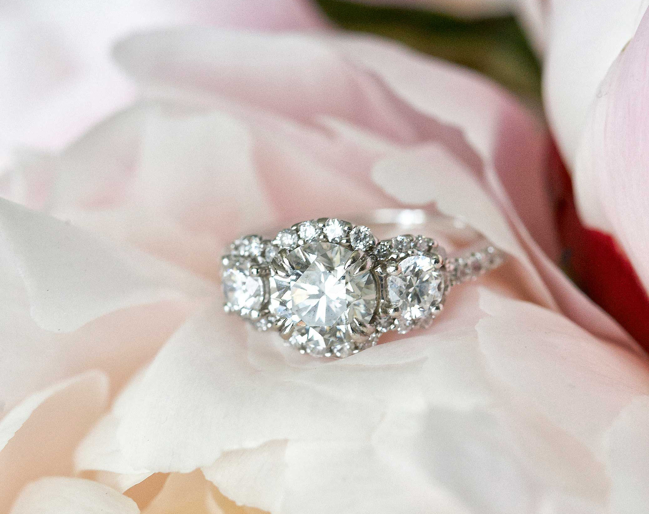 three stone diamond engagement ring with halo