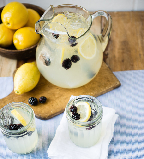 Lemonade Sparkler recipe with blackberries in pitcher and mason jars