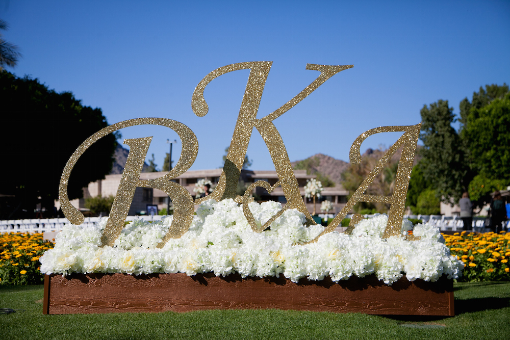 large glitter initials at wedding ceremony entrance