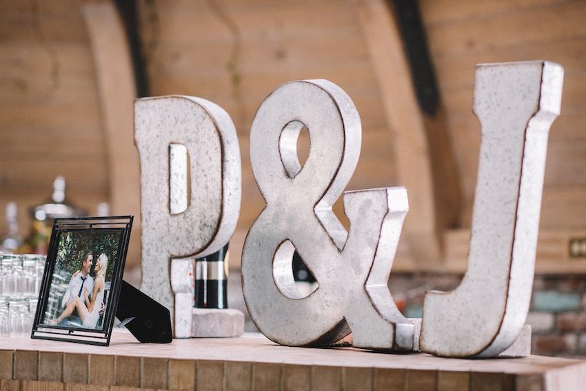 metal initials placed on wedding bar