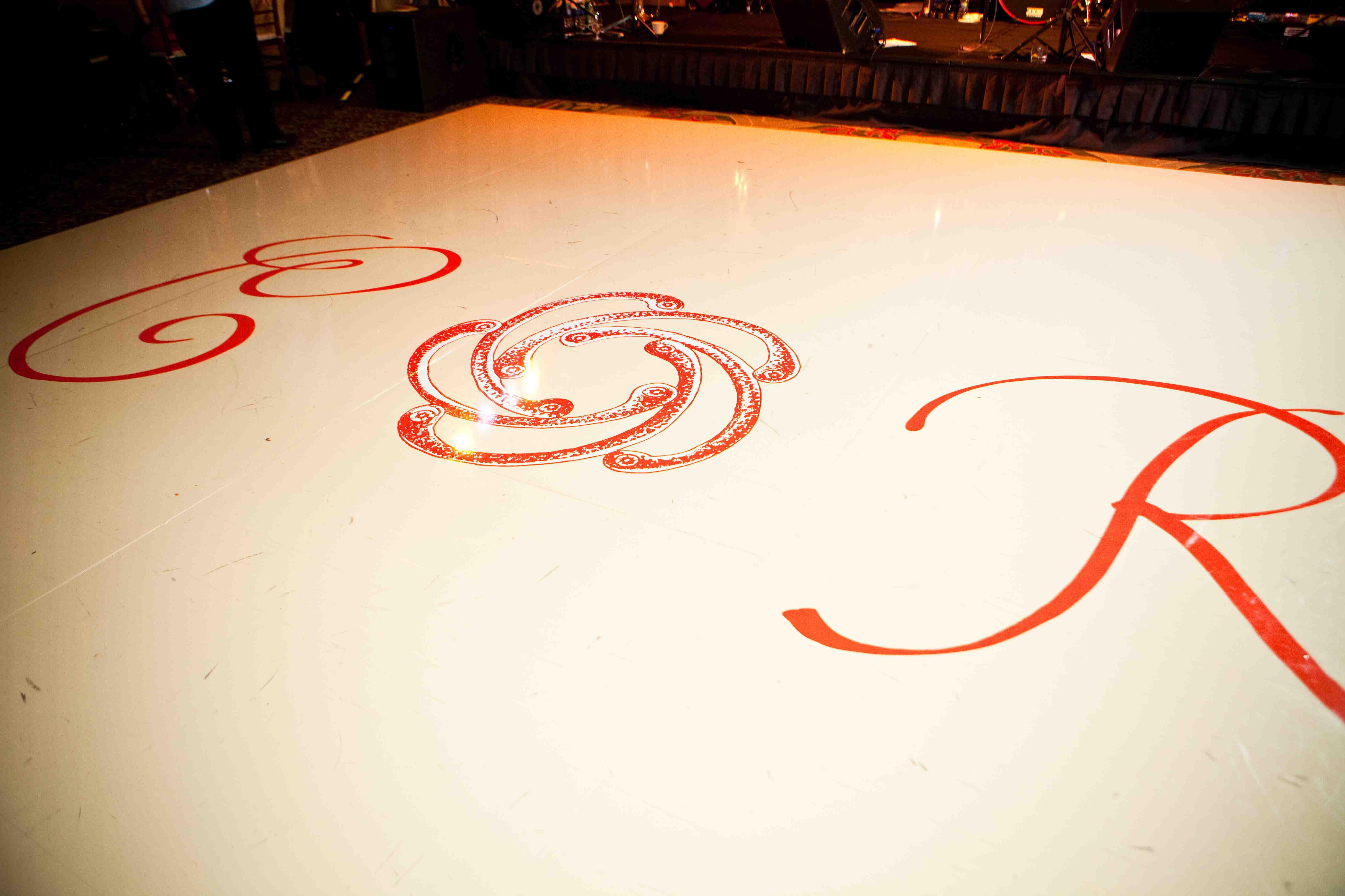 couple's initials on wedding dance floor