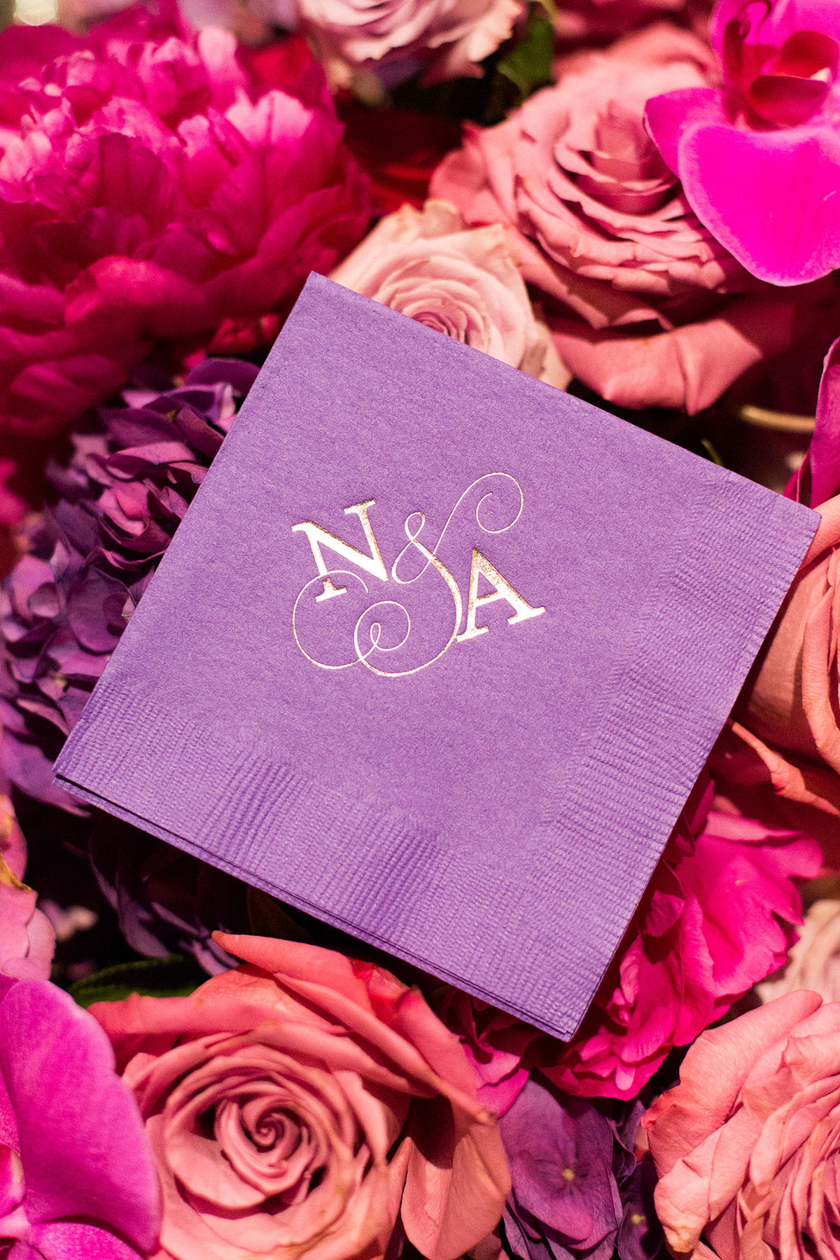 bride and groom's initials on cocktail napkin