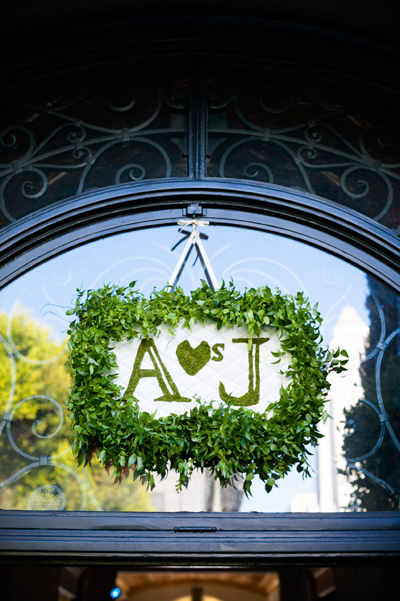 initials on moss sign at wedding ceremony entrance