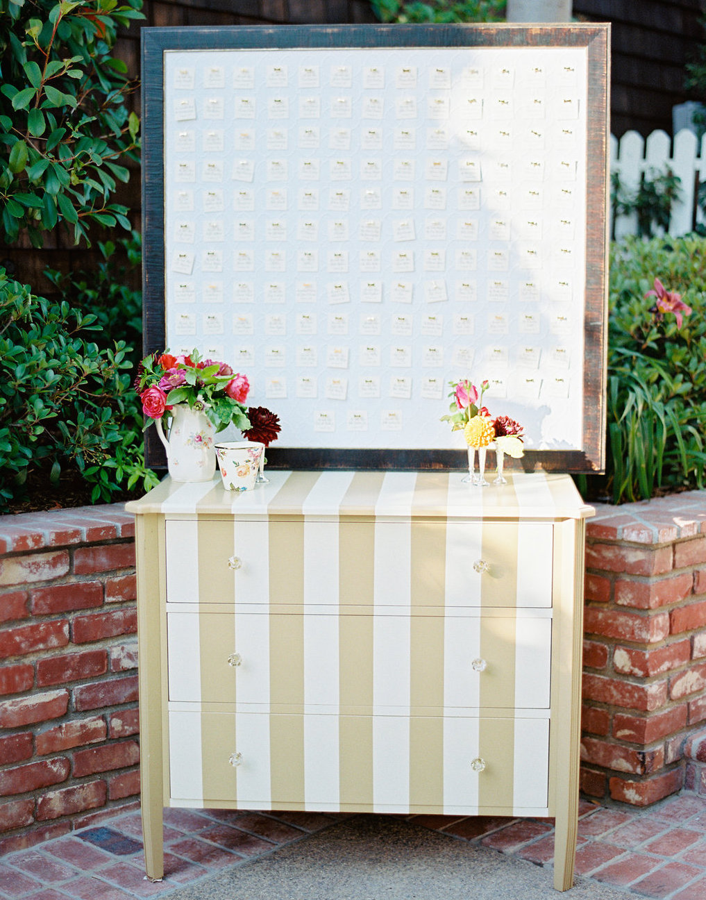 Gold and white stripe dresser for escort card display outdoor wedding