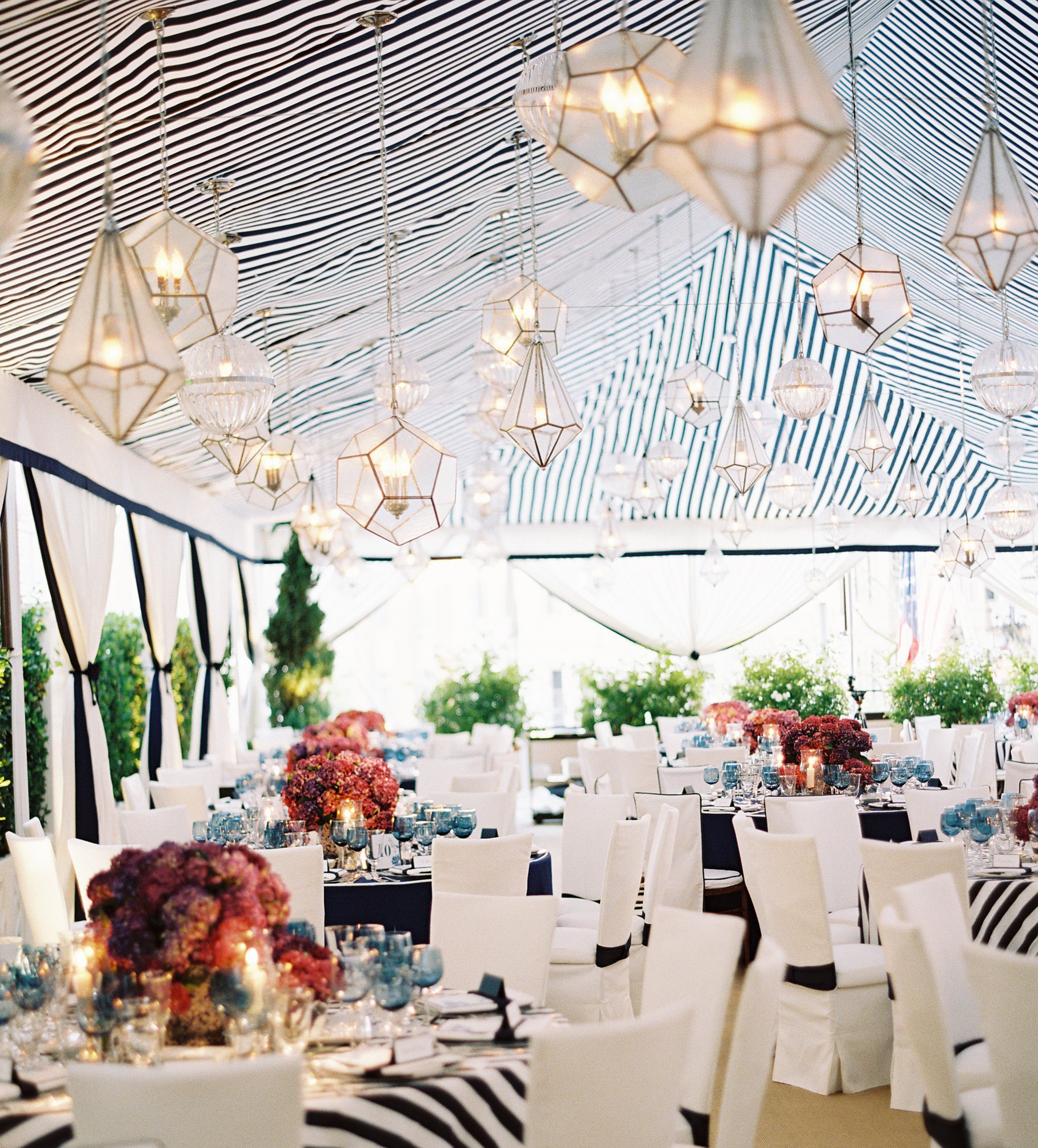 Navy blue and white stripe tent reception and linens for rehearsal dinner