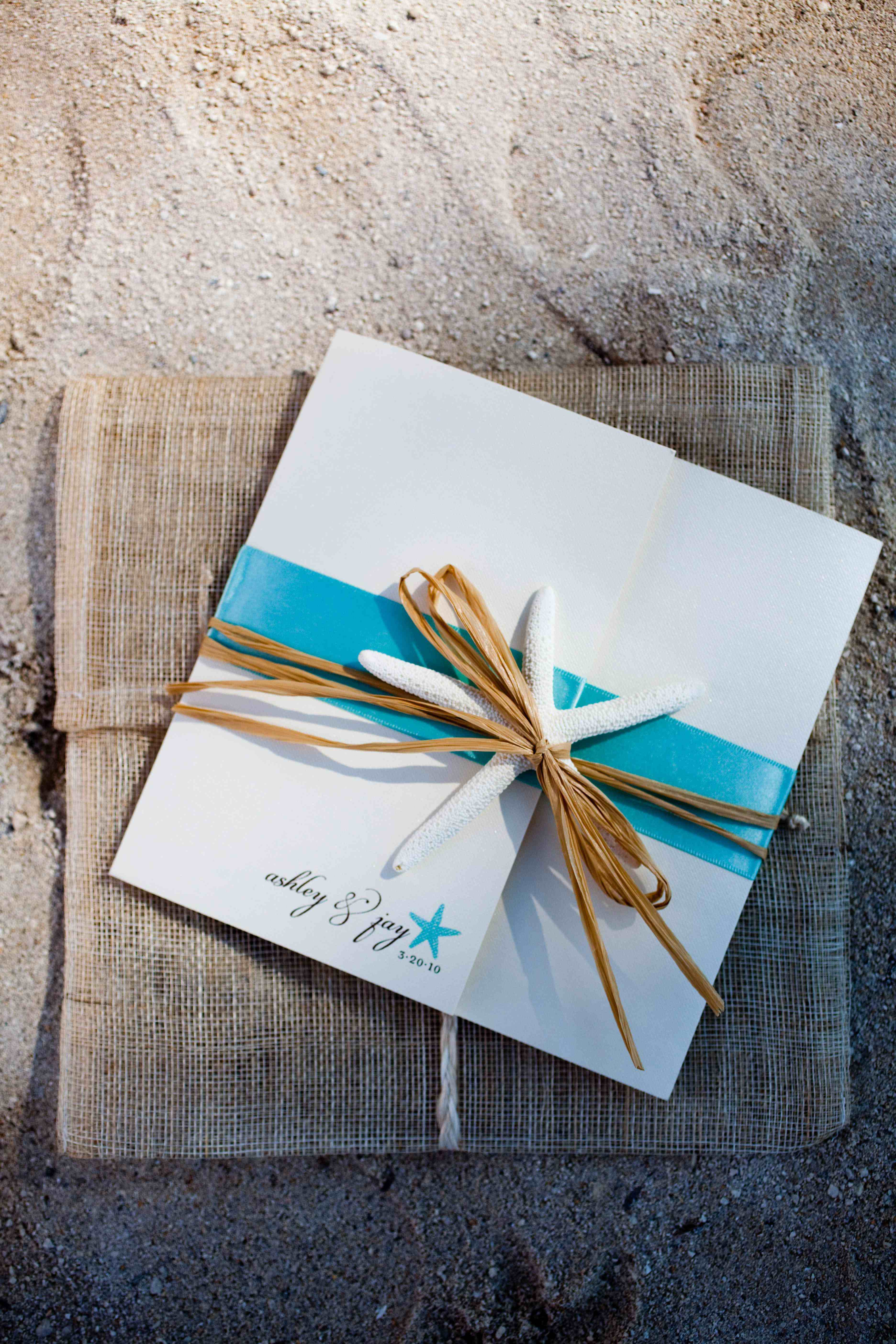 beach wedding invitation suite with burlap and a starfish