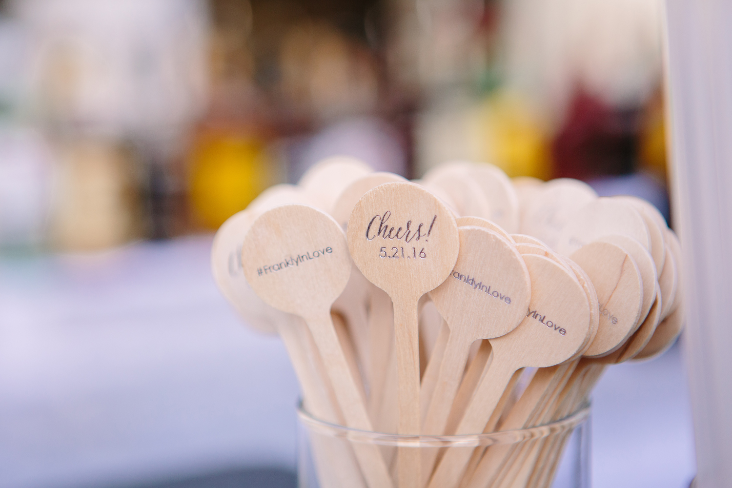 Wood drink stirrers with cheers wedding date and wedding hashtag