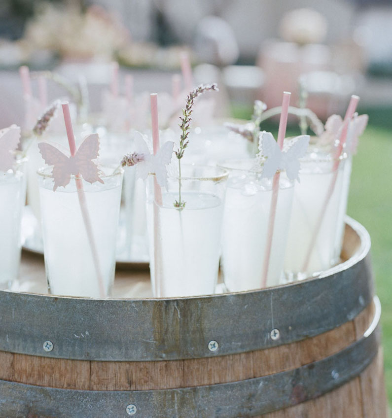 Lavender sprig and butterfly decals on pink straw wedding drink