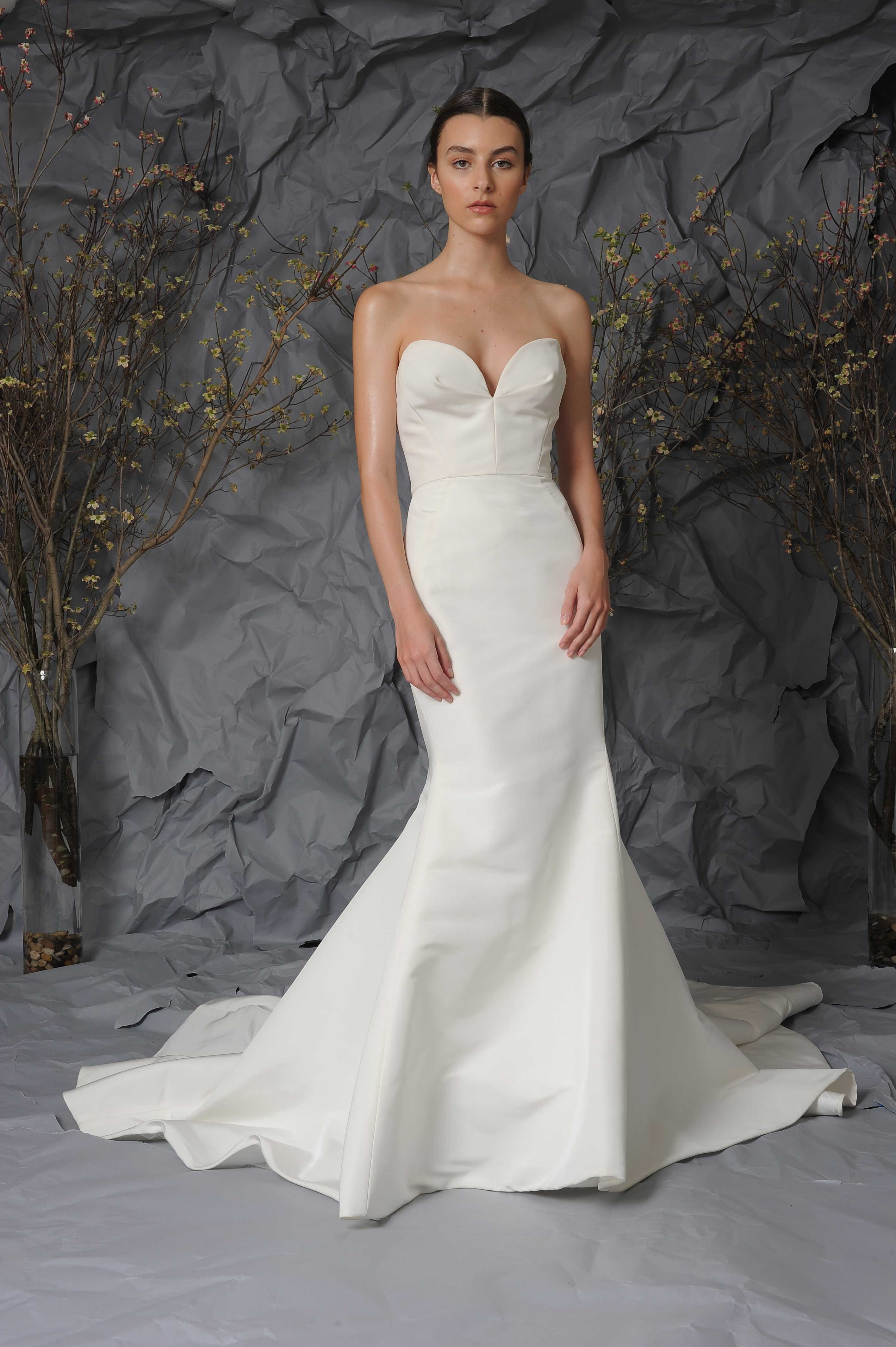Simple wedding dresses classic designer bridal gown for Wedding dress cleaning austin