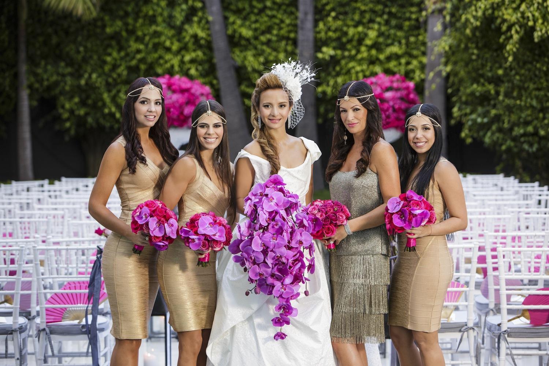 Bridesmaids in short bodycon gold metallic dresses and fringe 1920s dress headdresses