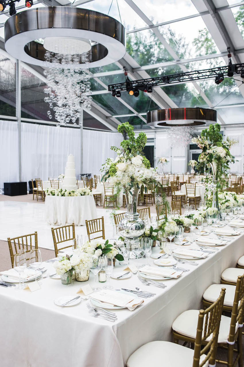Wedding with glass globe ceiling treatment over dance floor