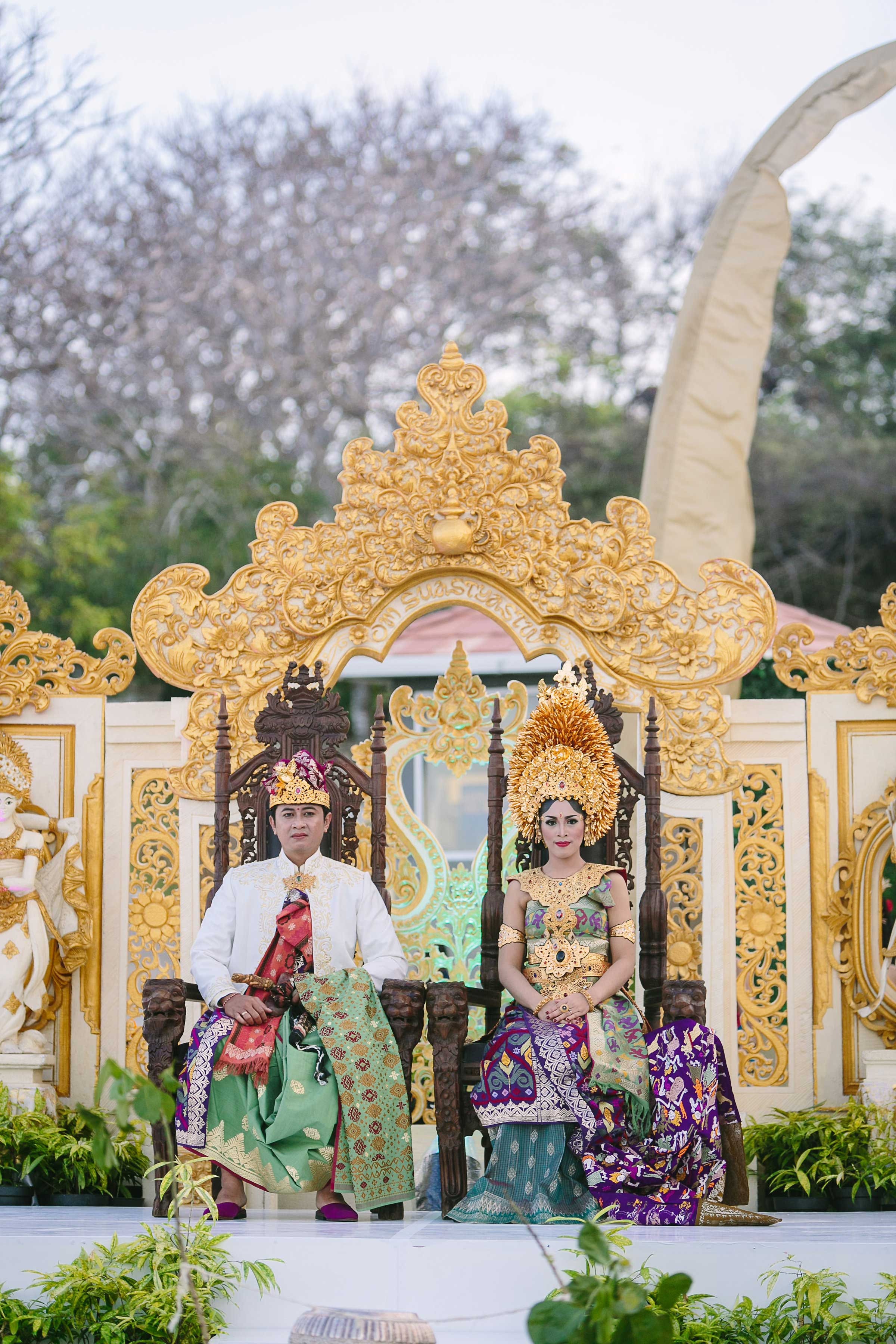 Bride and groom at gold thrones Balinese wedding show at The Mulia Resort in Bali