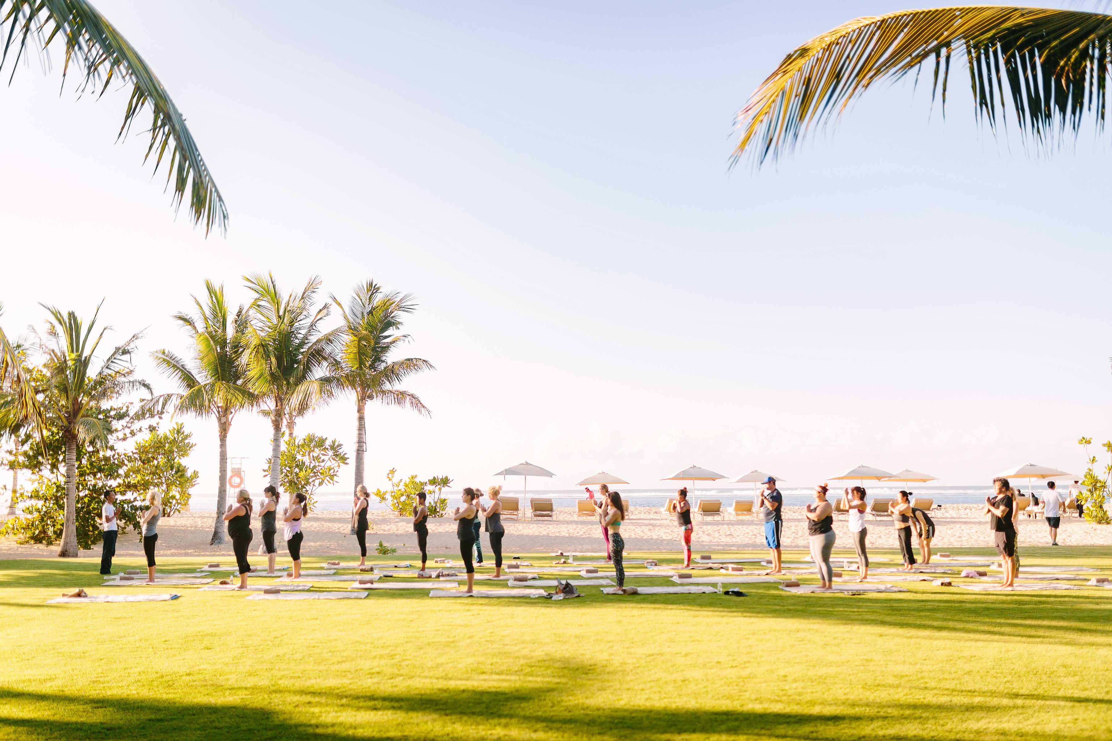 Yoga on lawn at Mulia Bali Resort for Marry at the Mulia event