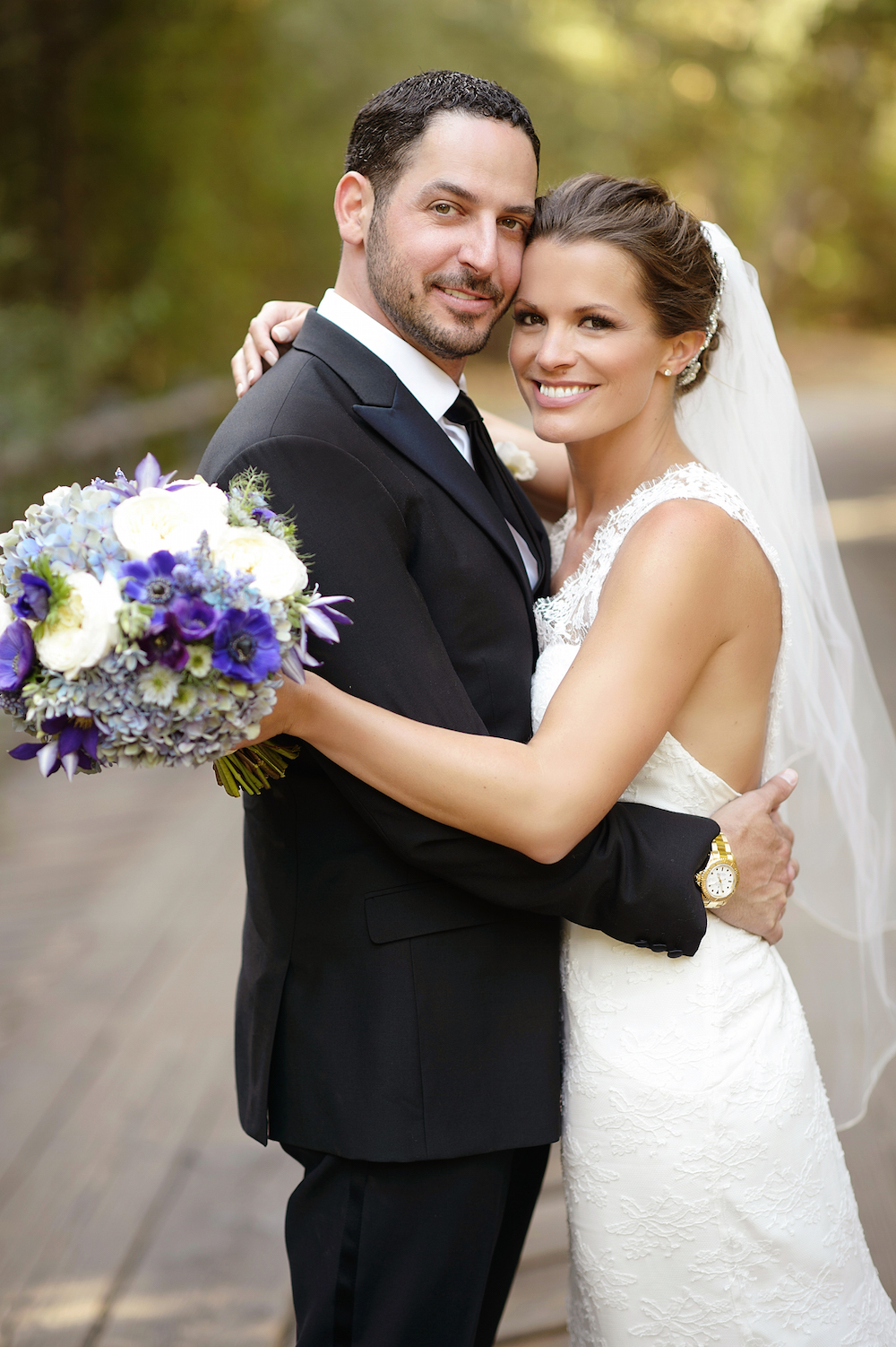 Melissa Egan wedding portrait holding purple anemone bouquet