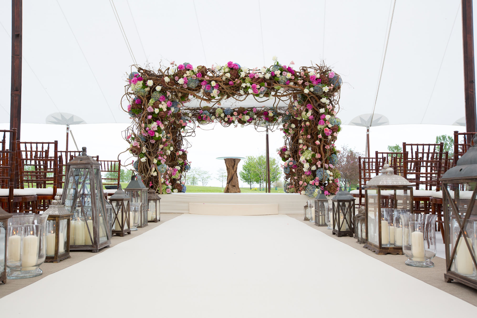 Wedding ideas decorating with lanterns inside weddings flower embellish chuppah with lanterns lining aisle runner junglespirit Gallery
