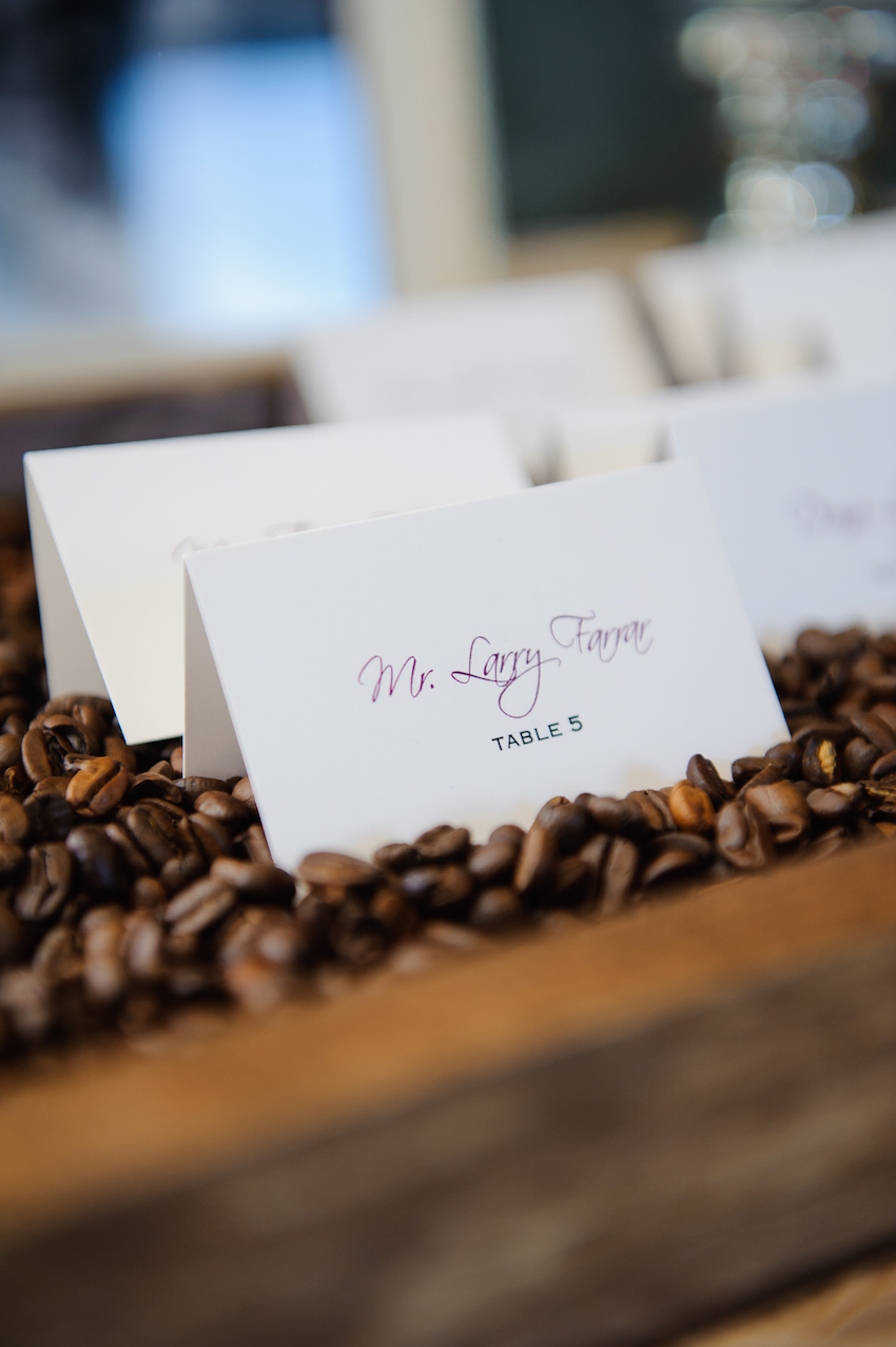 Escort card in tray filled with coffee beans