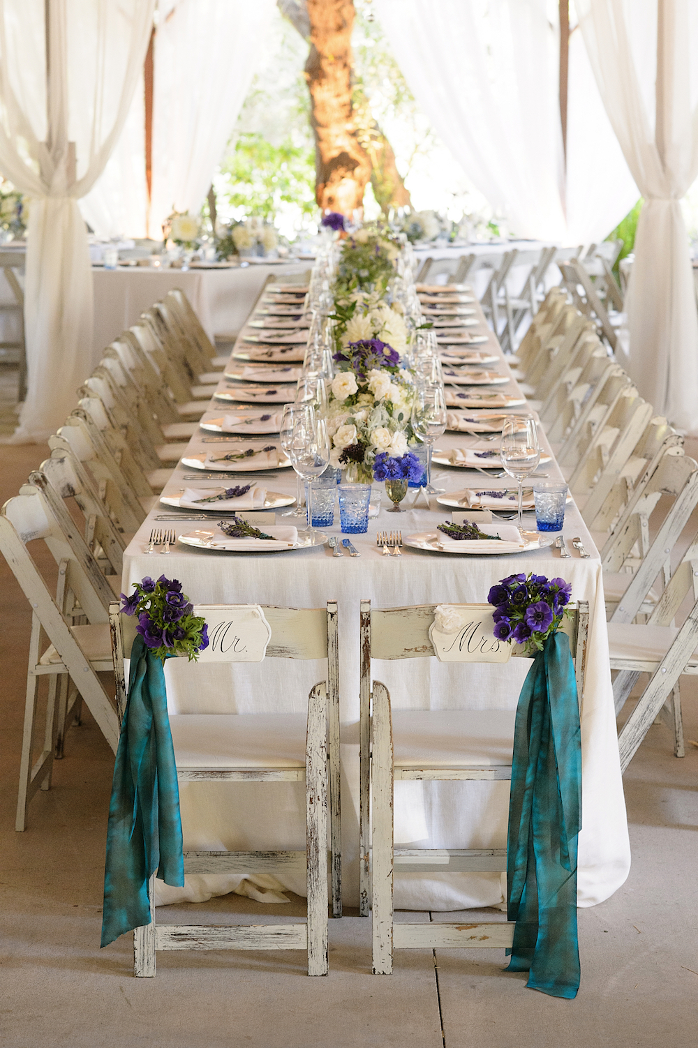 Purple anemone flowers on chair for wedding reception Melissa Claire Egan