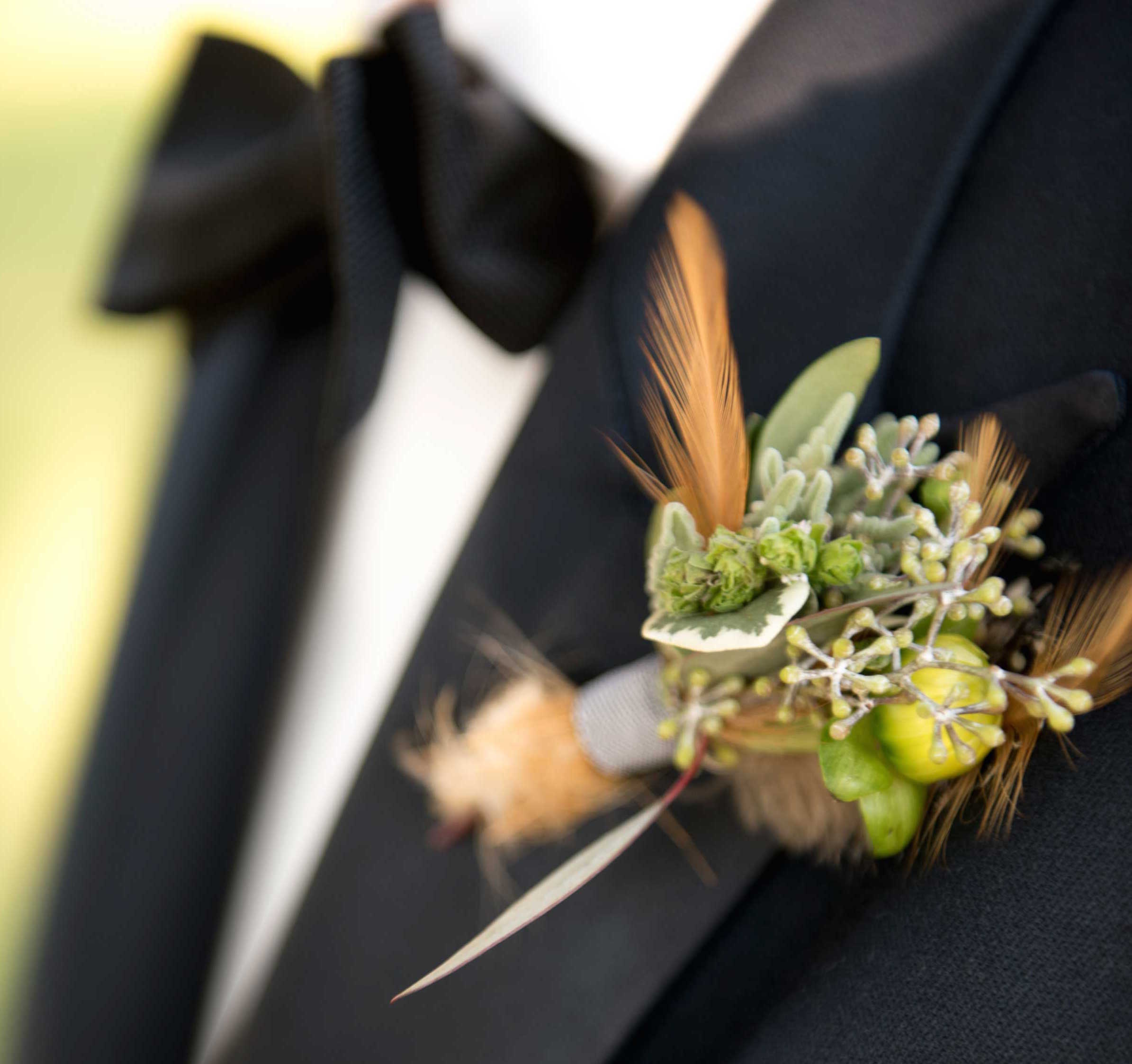 Feather and verdure wedding boutonniere
