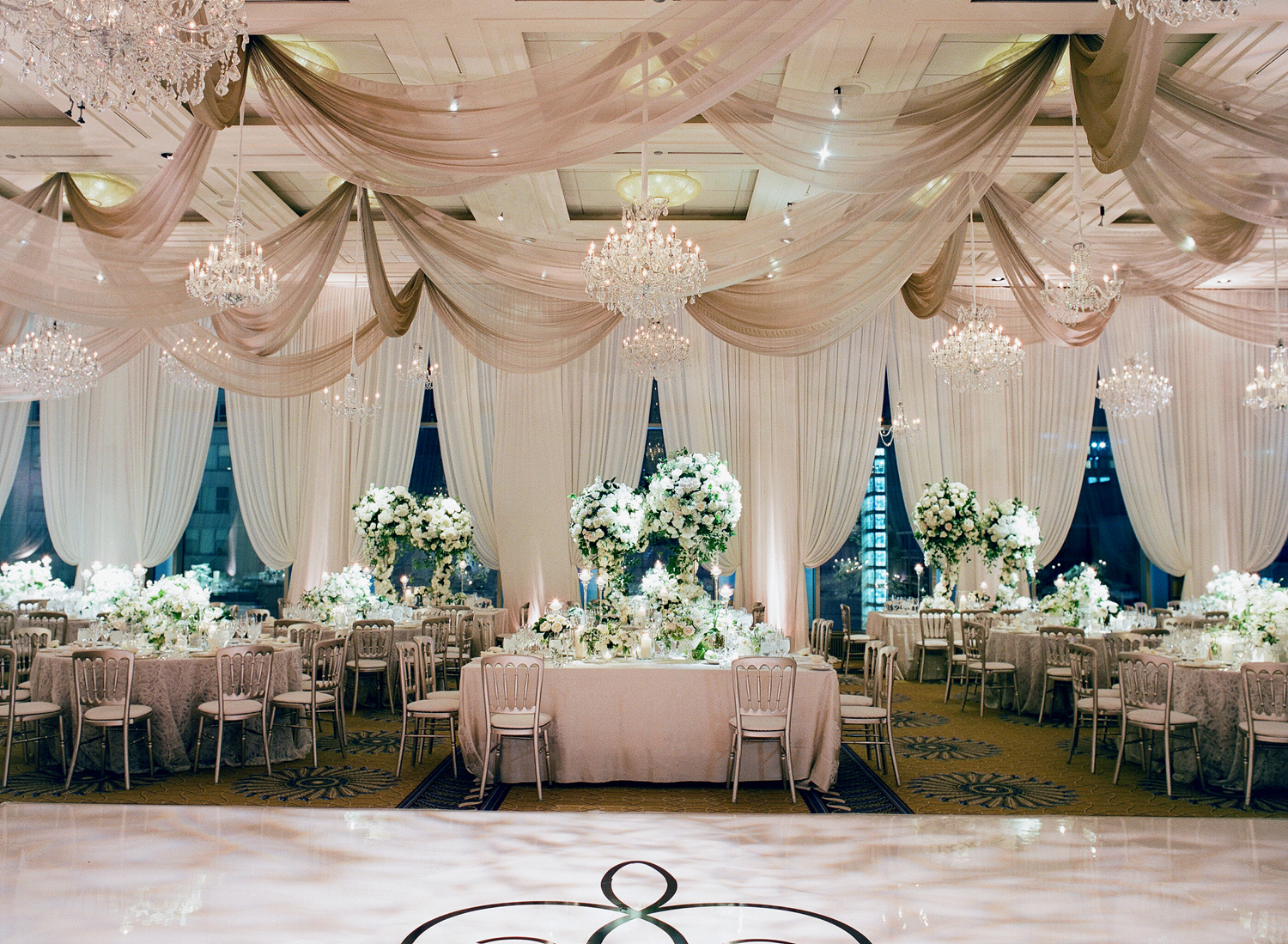 white and taupe wedding reception with lots of drapery