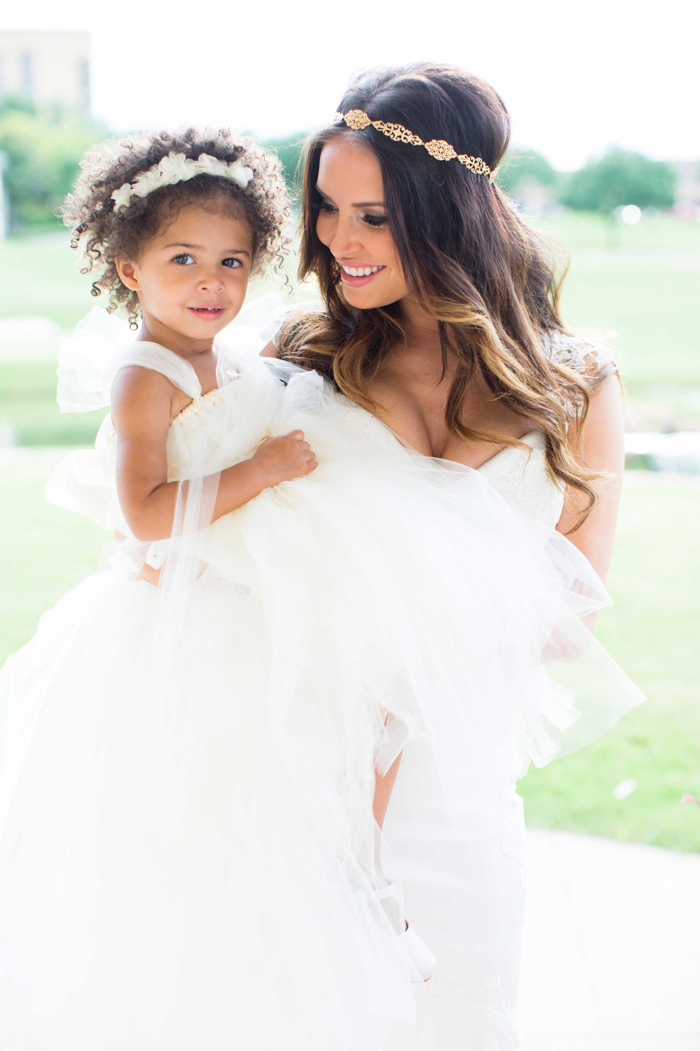 Heidi Mueller with her and DeMarco Murray's daughter on wedding day