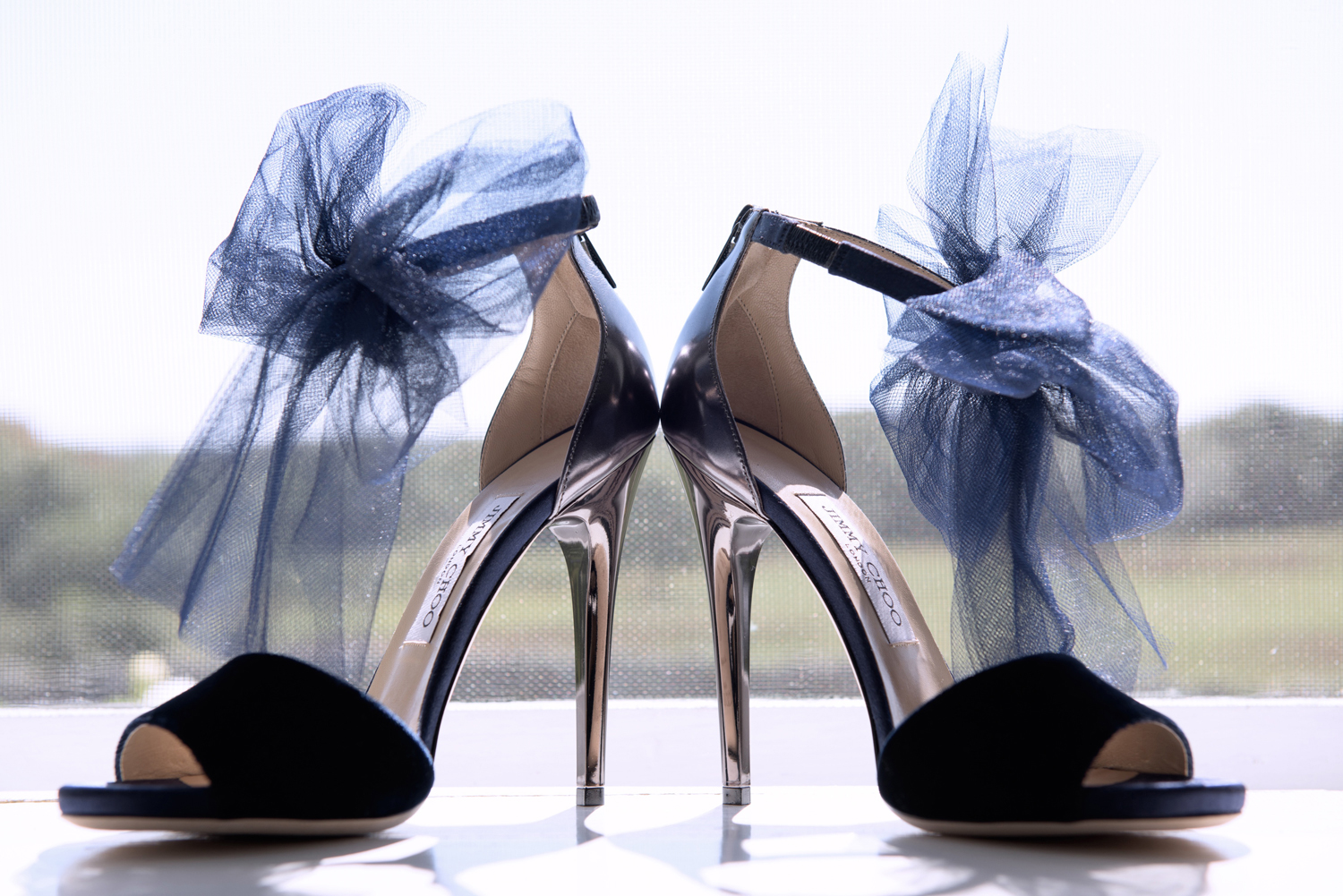 navy jimmy choo shoes with tulle bow at ankle strap, wedding shoes