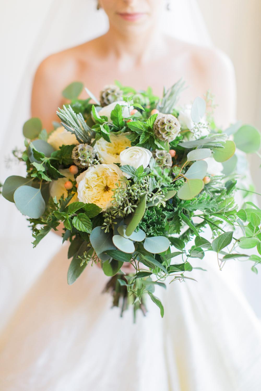 lush bridal bouquet with heavy greenery, eucalyptus, ivory garden roses